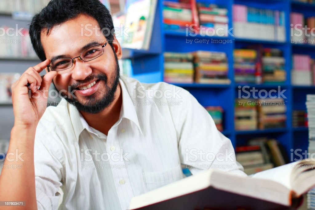 happy young professor in library royalty-free stock photo