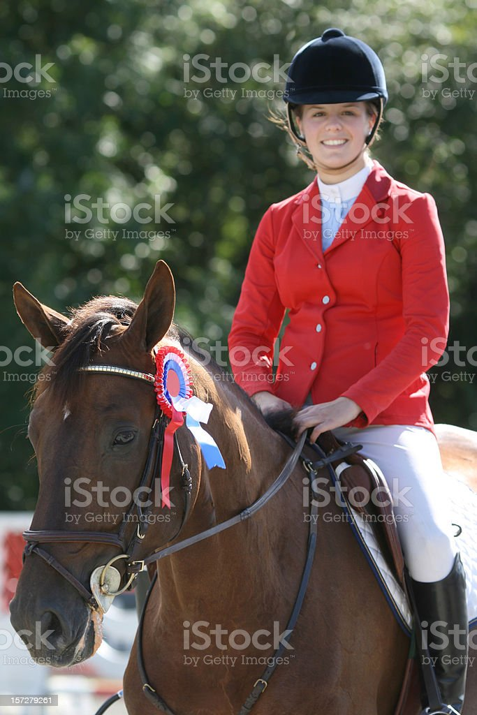 Happy young rider after winning a show jumping competition, Norway stock photo