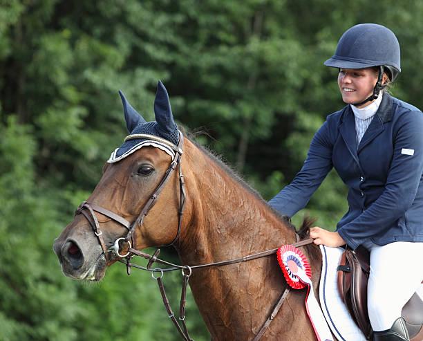 happy young rider after winning a show jumping competition, norway - hästhoppning bildbanksfoton och bilder
