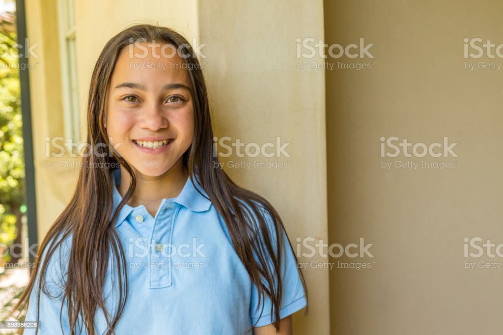 Happy Young School Girl at Home stock photo