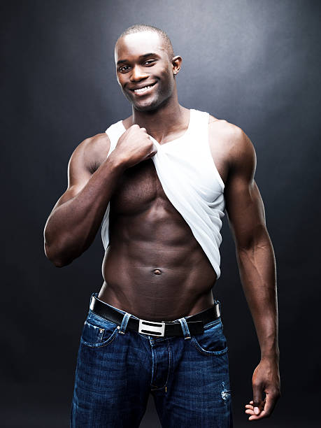 Happy, young, sexy man showing his abs stock photo