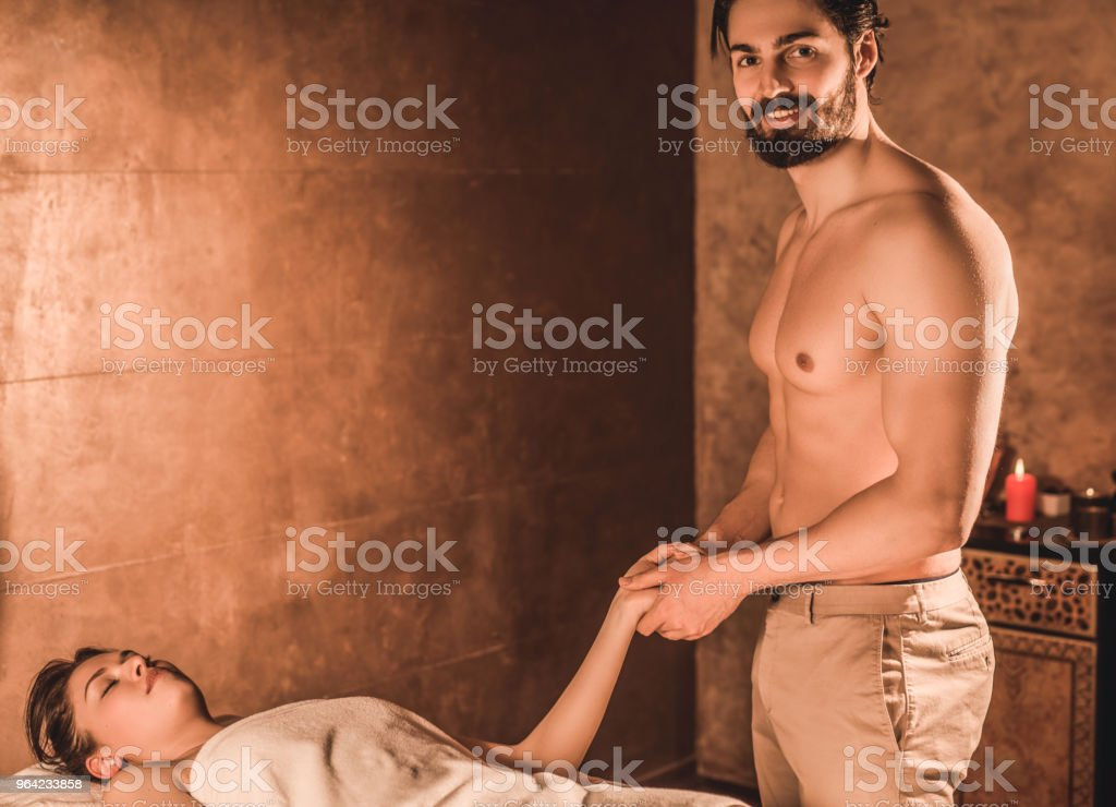 Happy Young Shirtless Male Massage Therapist Does His Best At Work Stock Photo Download Image Now Istock