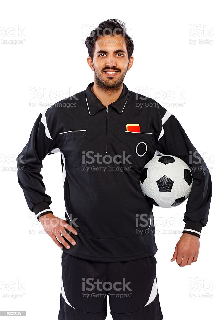 Happy young soccer referee with a football stock photo