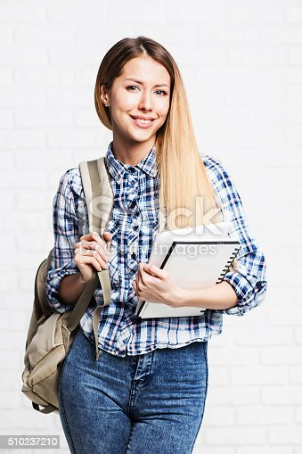 istock Happy young student girl holding notebook 510237210