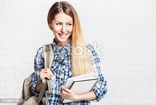 istock Happy young student girl holding notebook 510683780