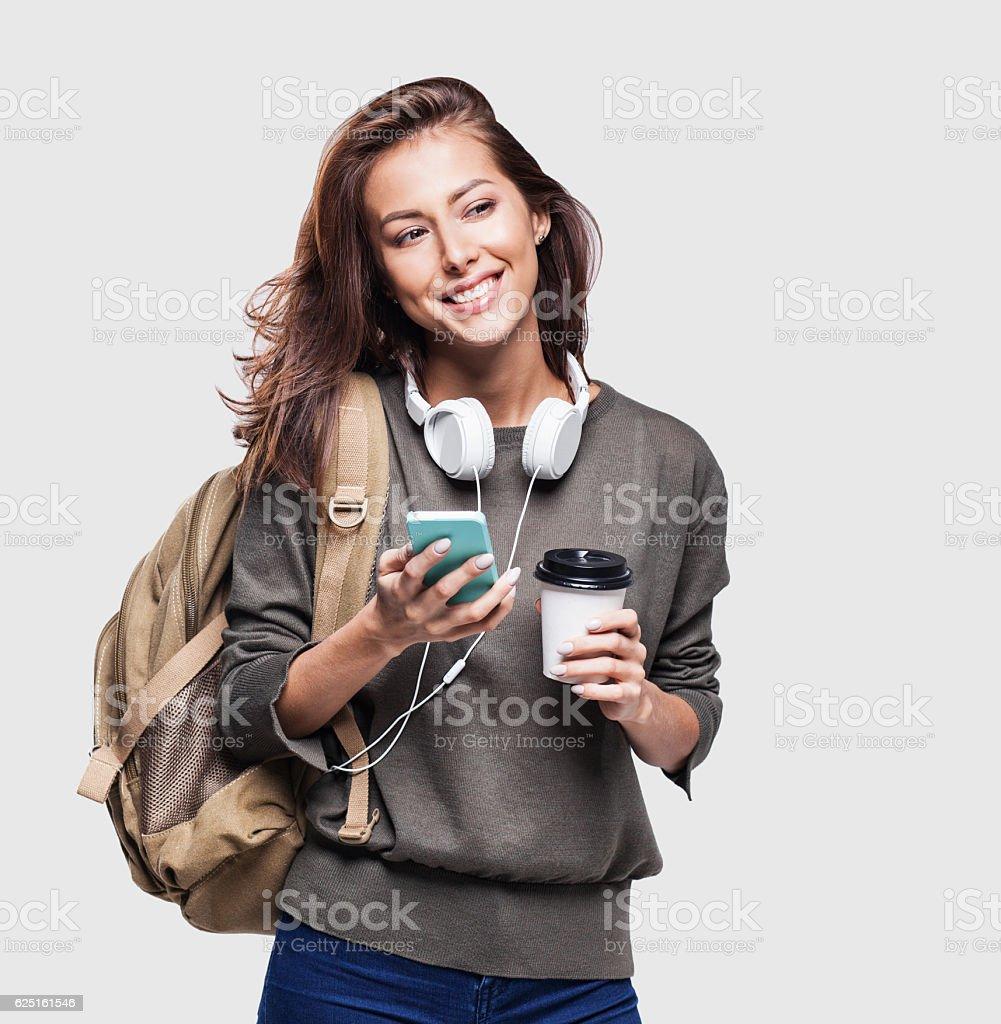 Happy young student girl using smart phone photo libre de droits