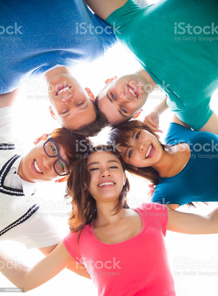 happy young student group looking down stock photo