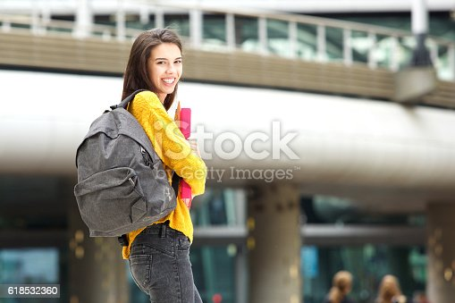 istock Happy young student walking on city campus 618532360