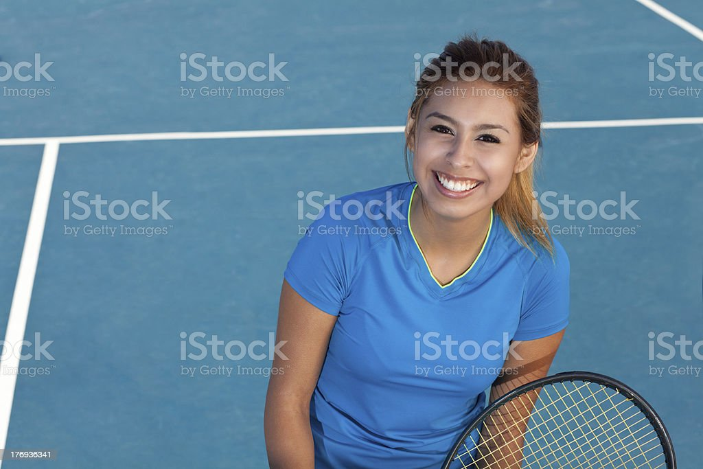 Happy young tennis player on court stock photo