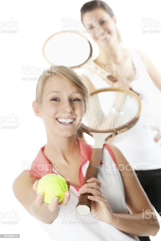 Happy Young Tennis Players, One Holding Ball Out royalty-free stock photo