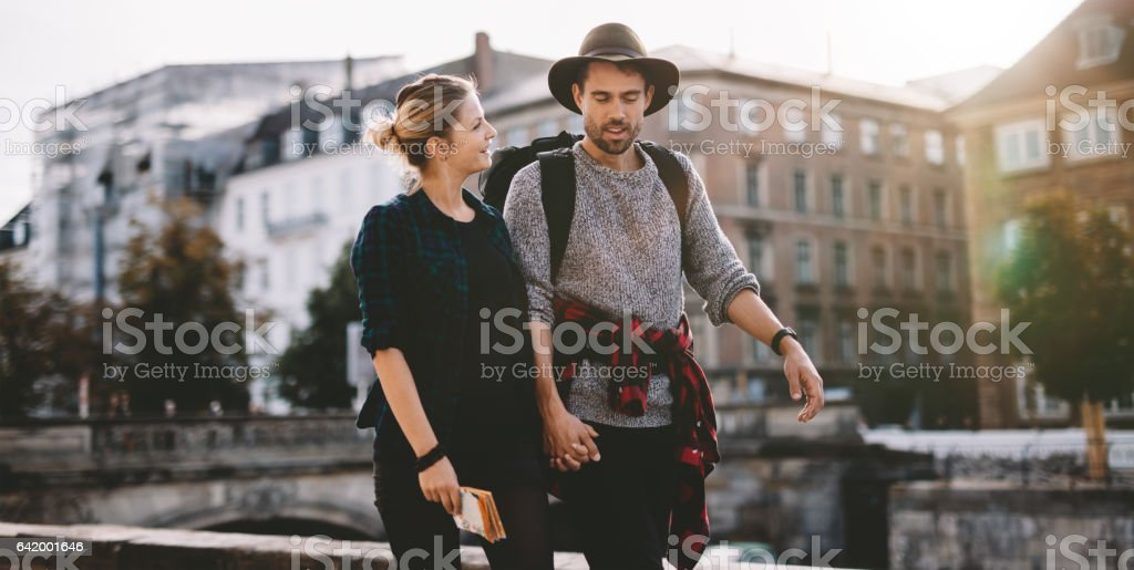 Happy young tourist couple on vacation. stock photo