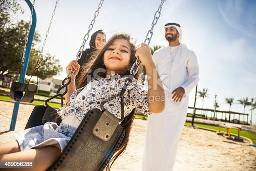 istock Happy young traditional family in Dubai, UAE 469056288