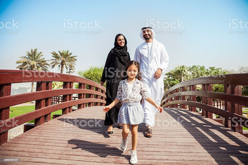 Happy young traditional family in Dubai, UAE stock photo