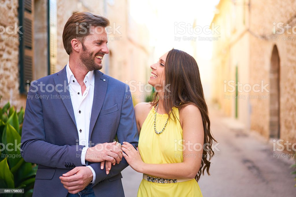 happy young woman and man walking in town stock photo