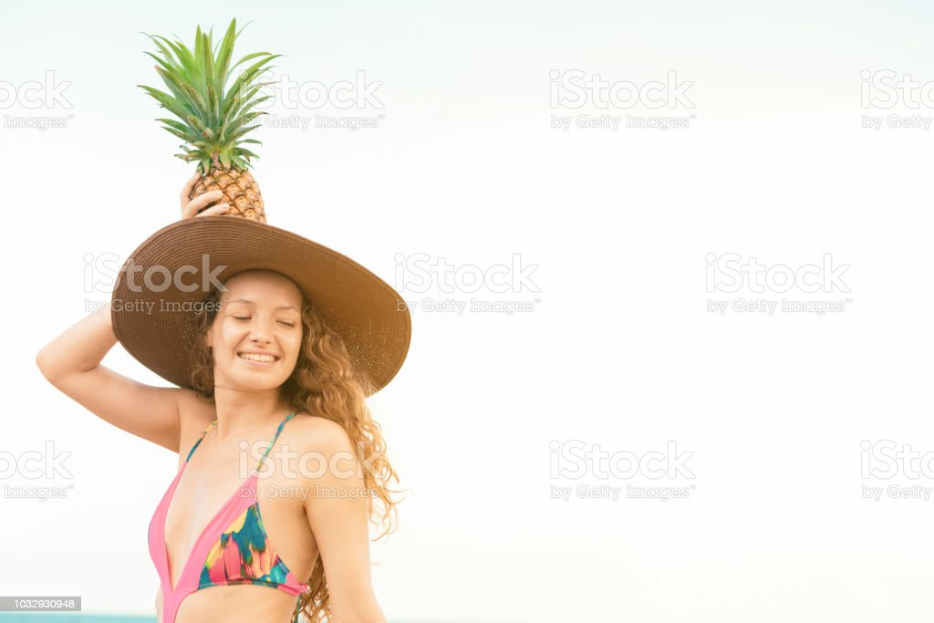 a5a1d0021fd Happy young woman at beach in summer vacation. royalty-free stock photo