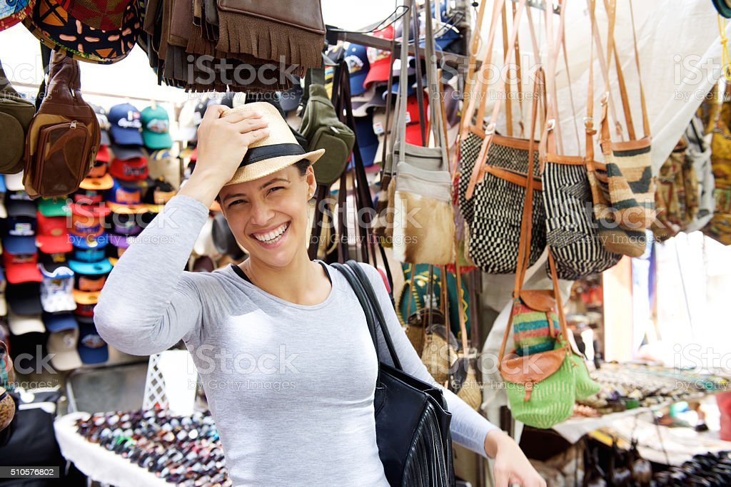 Happy young woman at market stock photo