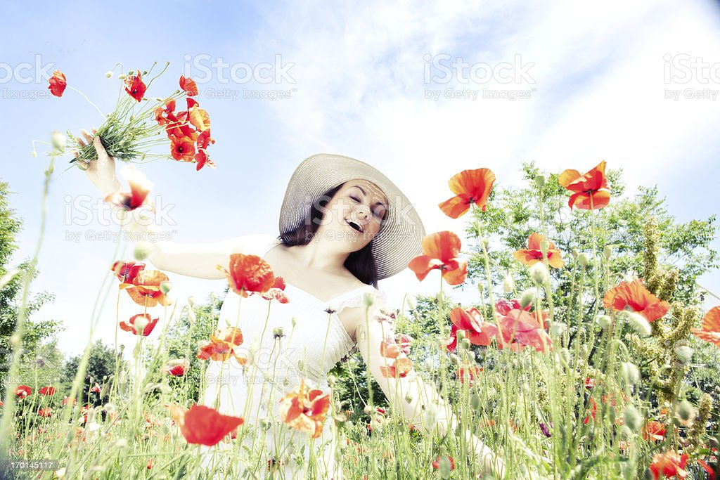 Happy Young Woman  at the Meadow of  Red Poppies royalty-free stock photo