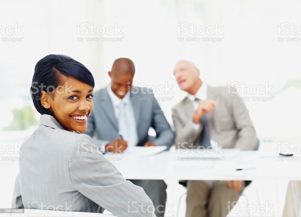Happy young woman being interviewed by panel of business people royalty-free stock photo