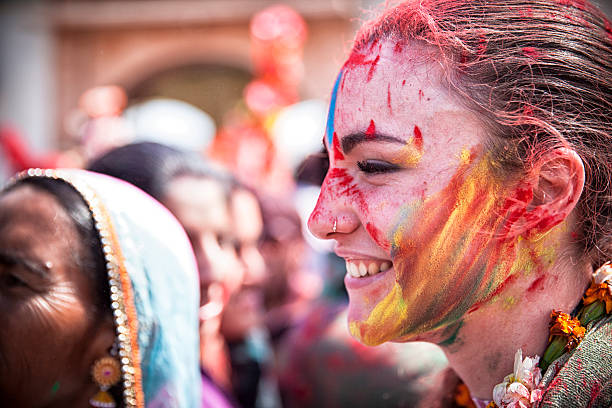 Happy young woman celebrating Holi in India. stock photo