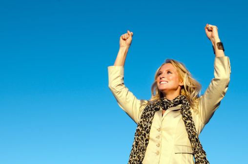 istock Happy Young Woman Cheering 183783671