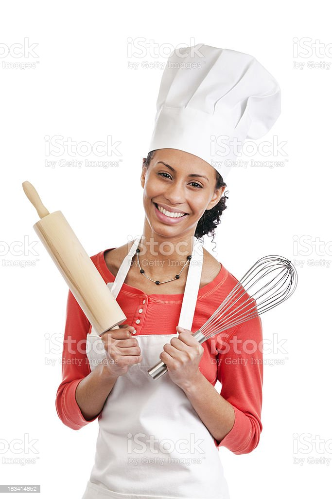Happy Young Woman Cook Wearing Apron and Chef Hat royalty-free stock photo