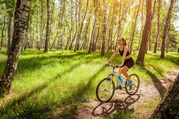 Happy Young Woman Cyclist Riding A Mountain Bicycle In