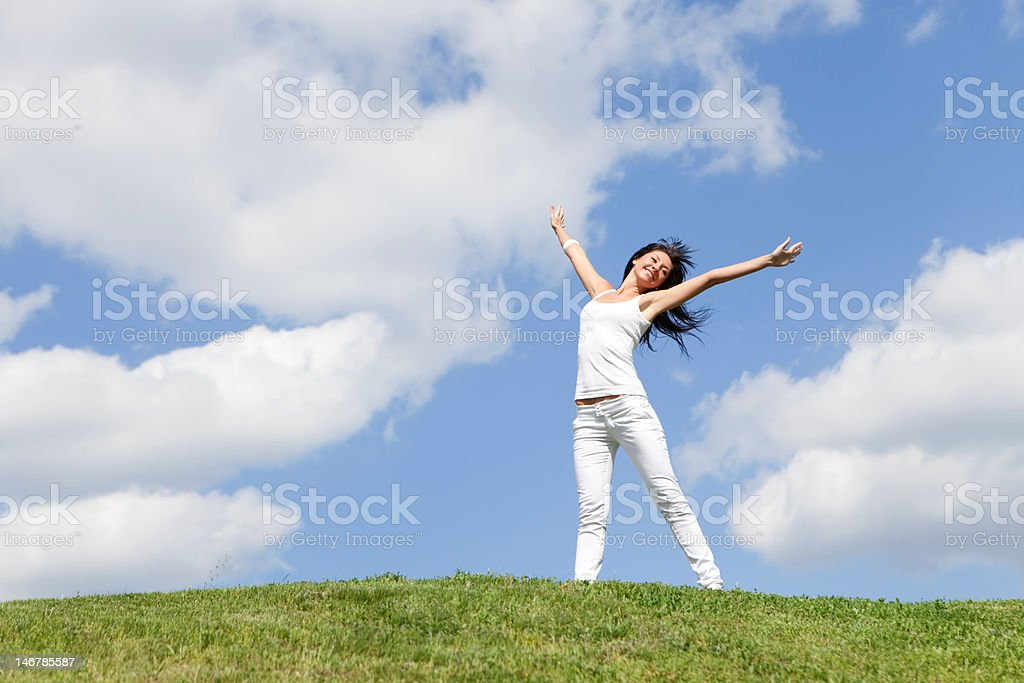 happy young woman dreams to fly on winds royalty-free stock photo