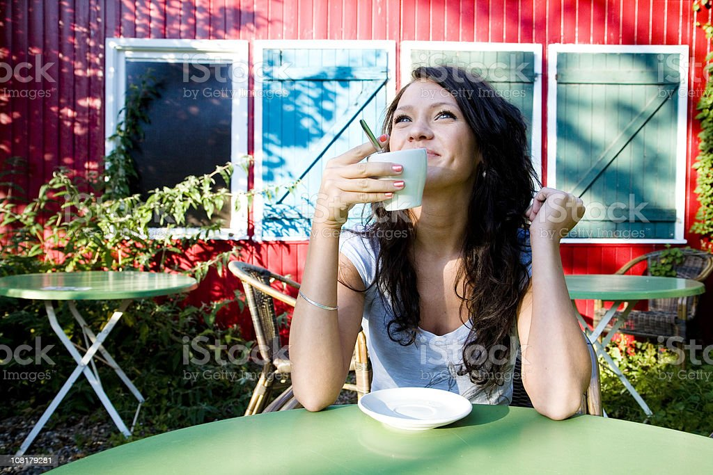 Happy Young Woman Drinking Coffee Outside royalty-free stock photo