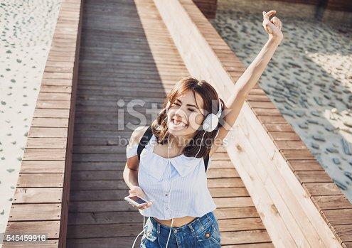 istock Happy young woman enjoying life 545459916