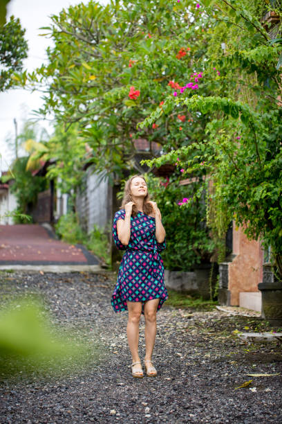 Happy young woman enjoying walk in old town street stock photo