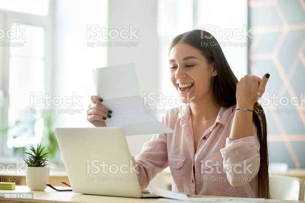 Happy young woman excited by reading good news in letter picture id963814336?b=1&k=6&m=963814336&s=612x612&h=moch5 qrkdtpygw3izjcbzeb5jmol4 yl  r kyeht0=