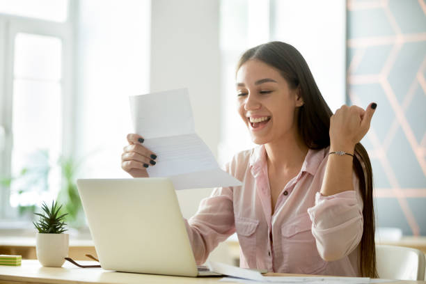 Happy young woman excited by reading good news in letter picture id963814336?b=1&k=6&m=963814336&s=612x612&w=0&h=c6nl4zzz8yo7hmxpufaixjfrwapwegwpz1xxabpflgc=