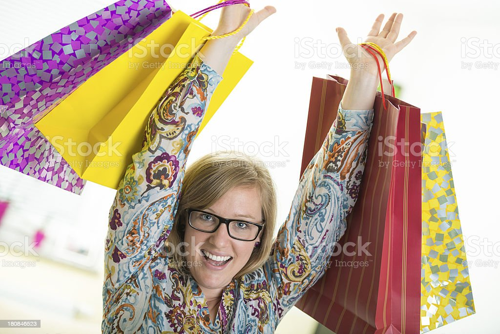 Happy young woman excited from shopping trip royalty-free stock photo