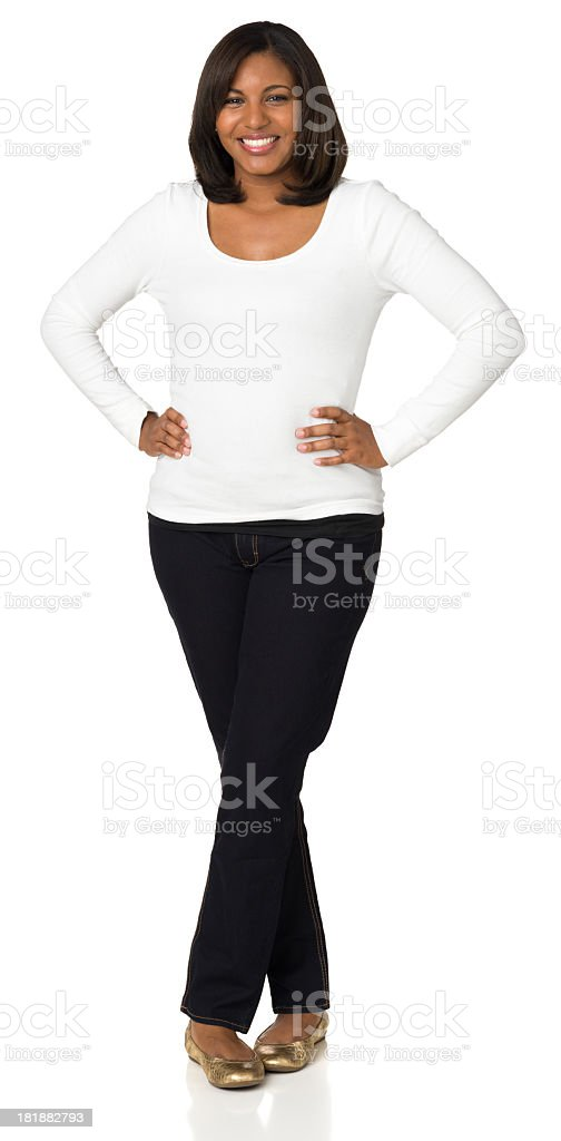 Happy Young Woman Full-Length Portrait, Hands On Hips, Legs Crossed stock photo