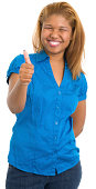 istock Happy Young Woman Gives Thumbs Up 173250785