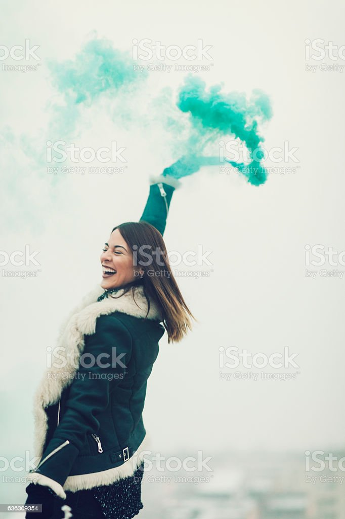 Happy Young Woman Having Fun Outdoors With Smoke Fountain. stock photo