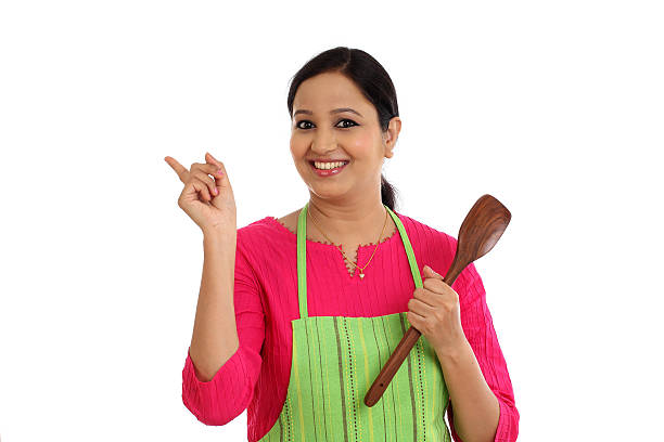 happy young woman holding kitchen ladle - dona de casa - fotografias e filmes do acervo
