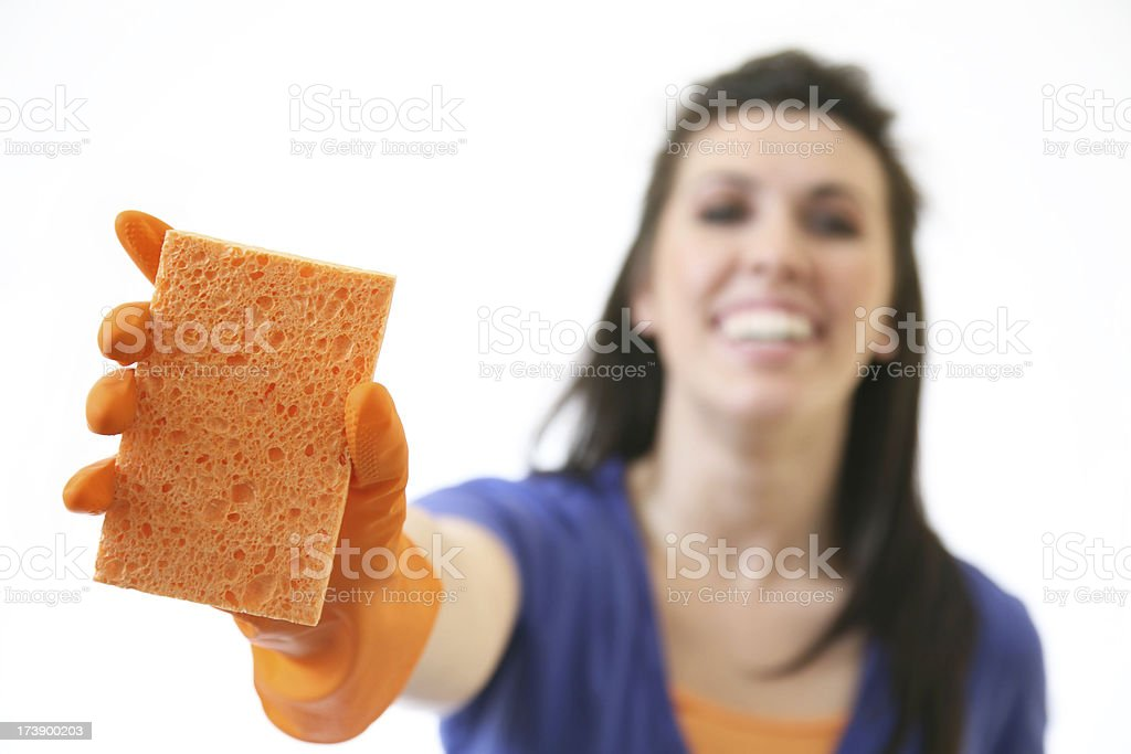 Happy Young Woman Holding Out a Cleaning Spunge royalty-free stock photo