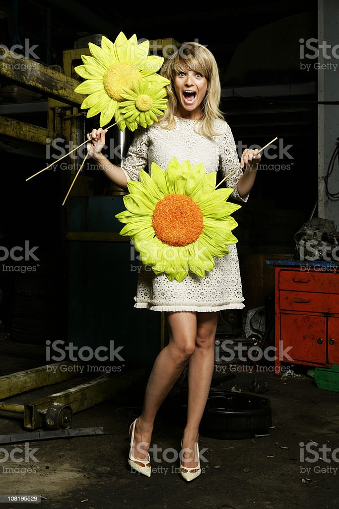 Happy Young Woman Holding Paper Flowers in Grunge Background stock photo