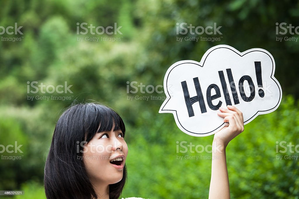 Happy Young Woman Holding Placard stock photo