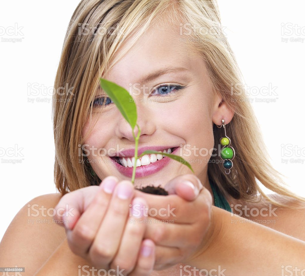 Happy young woman holding plant royalty-free stock photo