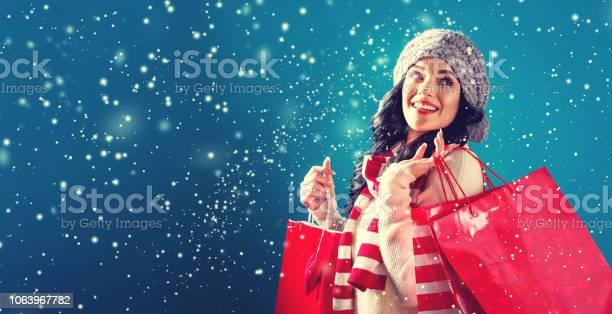 Happy young woman holding shopping bags picture id1063967782?b=1&k=6&m=1063967782&s=612x612&h=7 jym6gmy 3bzvhkdikqvbnml jqrqiwvdmvgizejjk=