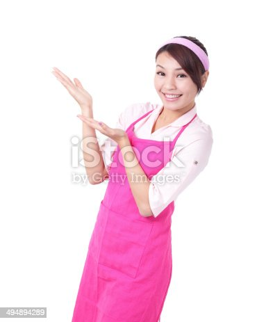 istock Happy young woman housewife showing 494894289