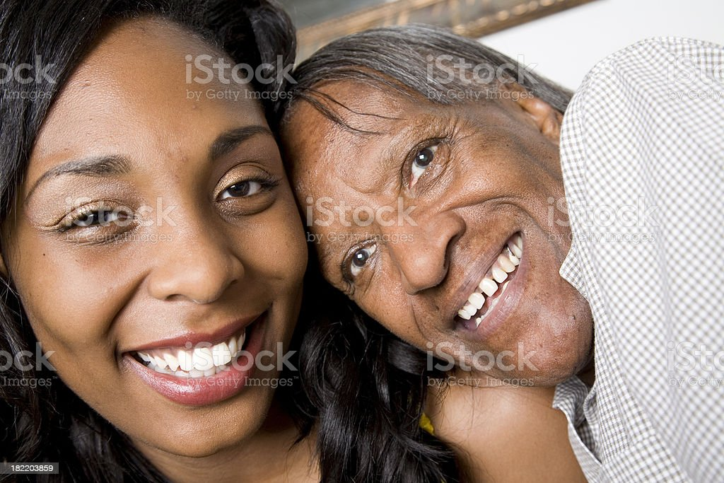 Happy Young Woman Hugging her Grandmother royalty-free stock photo