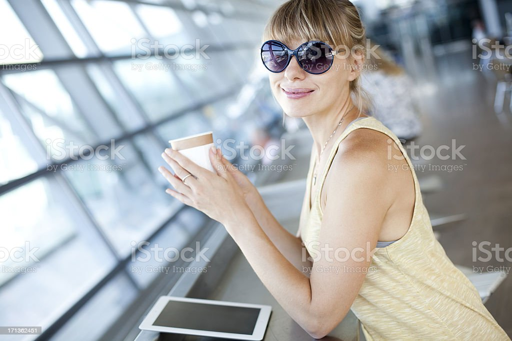 Happy Young Woman In Airport Cafe royalty-free stock photo