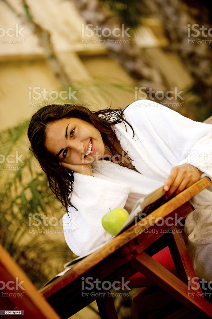 Happy young woman in bathrobe royalty-free stock photo