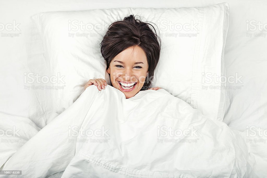 Happy Young Woman in Bed stock photo