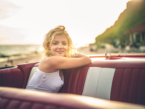 Happy Young Woman In Convertible Car Stock Photo - Download Image Now