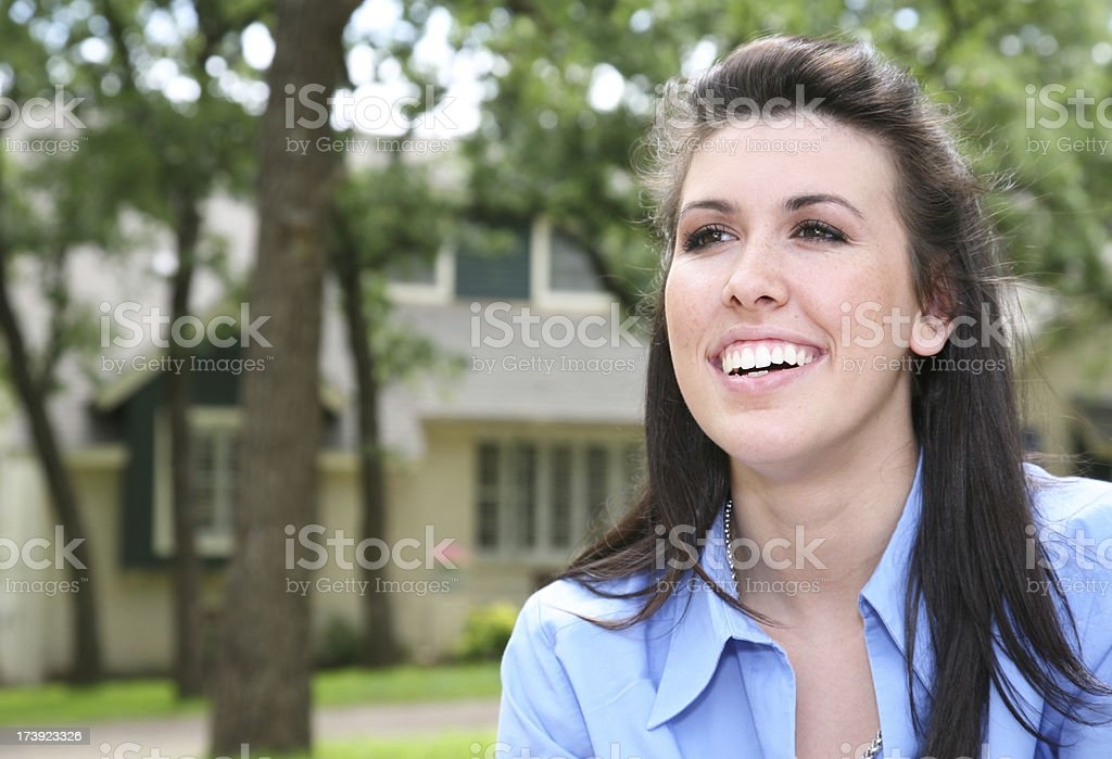 Happy Young Woman in front of her house royalty-free stock photo