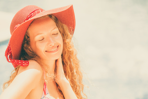 1062333060 istock photo Happy young woman in swimsuit at swimming pool. 1019716064